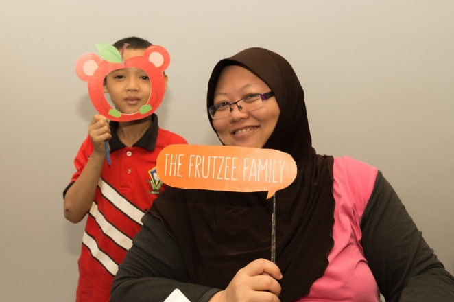 family is having fun with Frutzee photo props (2)